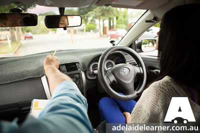 driving instructor teaches observation skills